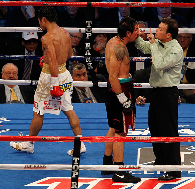 Twice during the 11th, Pacquiao looked to the referee as if to ask when he'd stop the fight. The stoppage never happened.