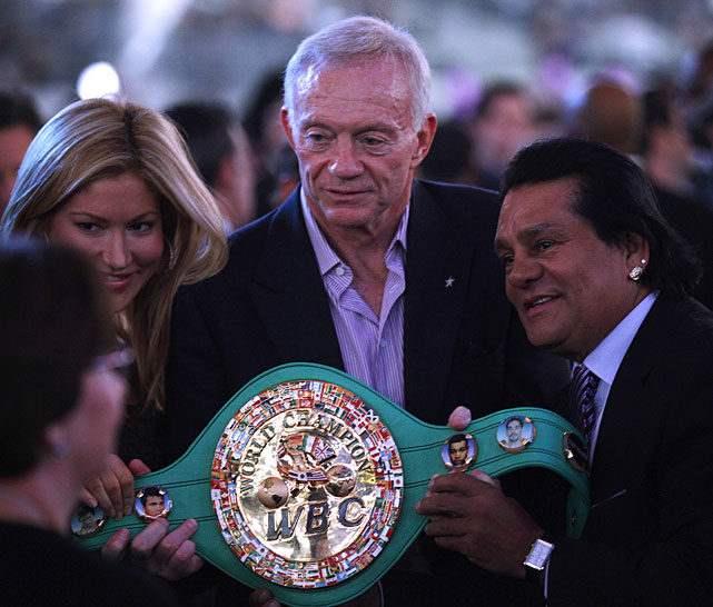 Jones, the Dallas Cowboys owner and general manager, poses with the WBC super welterweight title belt.