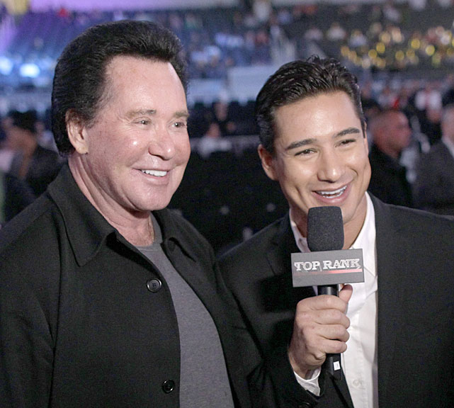 Lopez (right), the  Saved By The Bell  alum turned boxing analyst for Top Rank Promotions, interviews Las Vegas legend Newton.