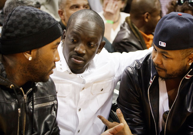 Young Jeezy (left), Akon (middle) and The Dream sit courtside to see their Atlanta Hawks.
