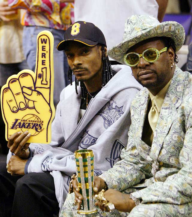 "Snoop, a devoted West Coast fan, spreads some Laker love with fellow rapper Don ""Magic"" Juan."