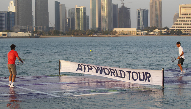 "Roger Federer and Rafael Nadal opened the tennis season on Jan 2, 2011, by hitting tennis balls on a court laid in the water of Doha Bay, Qatar. The two faced off to promote the Qatar Open. ""It was good fun. It was so different. You're always excited and nervous to see how it will turn out. It is always nice promoting an event and an entire tour with Rafa,"" Federer said of the event."