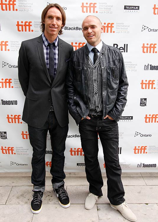 Nash smiles for the camera with Ezra Holland before the premiere of their movie Into the Wind in 2010.  The story, Nash's filmmaking debut, details the tale of Terry Fox, a marathon runner trying to raise cancer awareness.  It was featured in ESPN's 30 for 30 campaign.