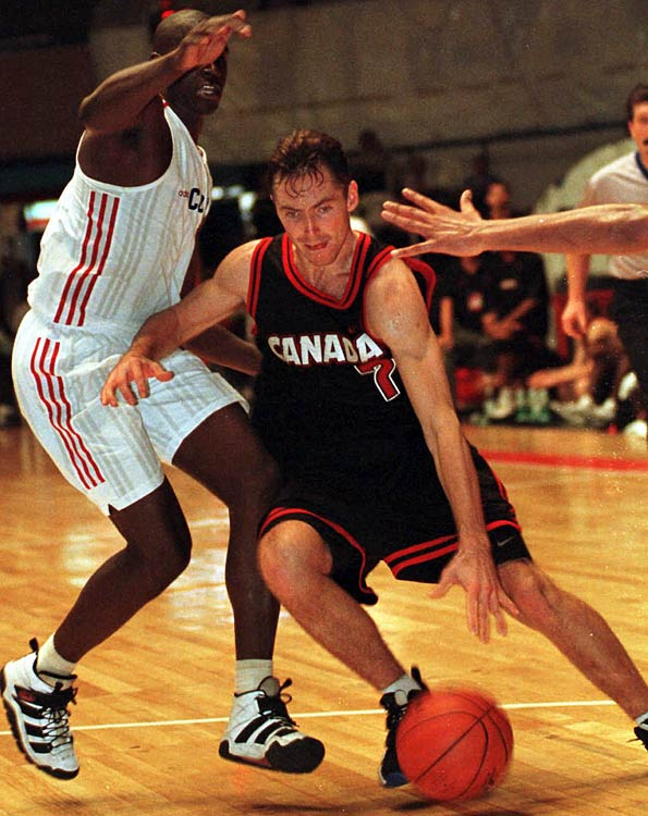 Nash also competed for the Canadian National Team, culminating in the team's appearance at the 2000 Olympics in Sydney. He also captained the team in 2004, but it did not qualify for an Olympic spot.   In this photo, Nash drives around Cuba's Yudi Abreu during a Tournament of the Americas game in Montevideo, Uruguay.