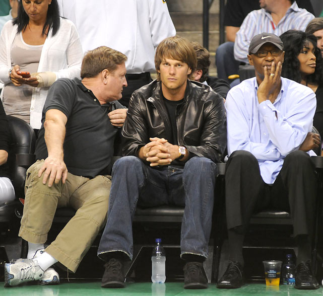 "Brady sits next to and Joe ""Jellybean"" Bryant, father of Kobe, during last year's NBA Finals."