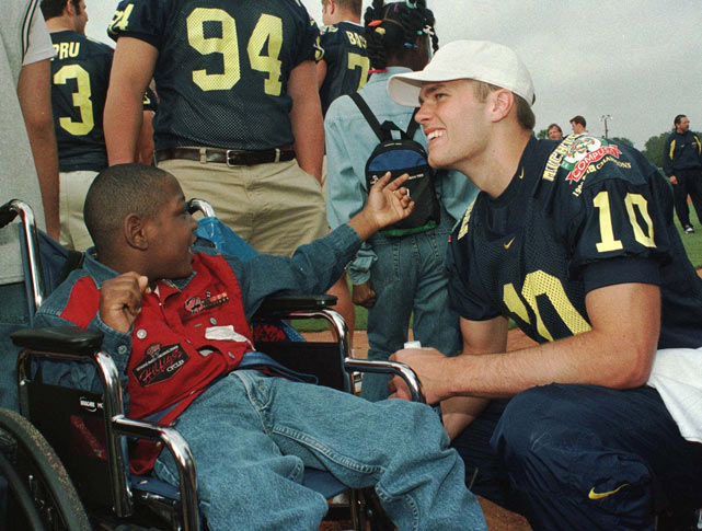 Brady and his teammates spend an afternoon with underprivileged children before the start of the 1998 season.