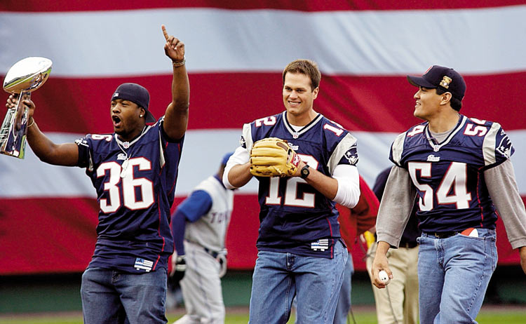 After bringing the first Super Bowl title to New England, the Patriots were the toast of the town. In this photo, Lawyer Milloy, Tom Brady and Ted Bruschi throw out the first pitch of the 2002 Boston Red Sox season.
