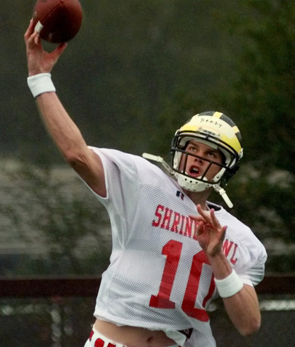 NFL scouts had differing opinions on Brady (seen here during the East-West Shrine Classic). Though he was accurate and possessed a high football IQ, he didn't run well and threw a poor deep ball. Eventually, New England coach Bill Belichick selected Brady with the 199th overall pick in the 2000 Draft.