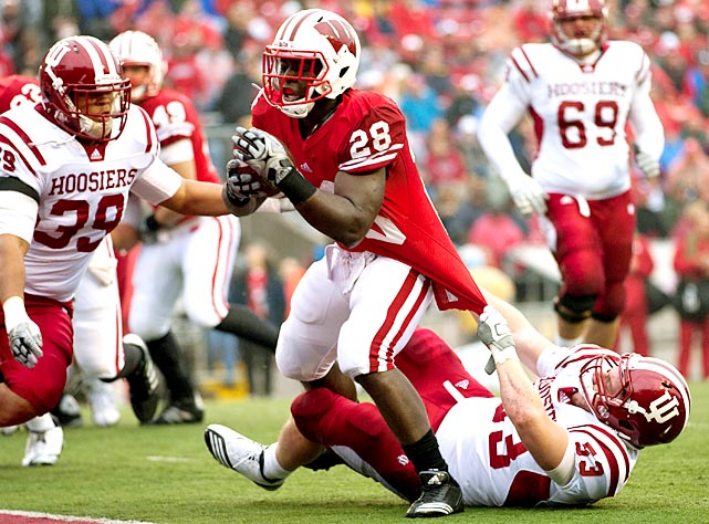 Wisconsin was without reigning Big Ten offensive player of the year John Clay on Saturday. Clearly, it didn't matter. Backup tailbacks Montee Ball (pictured) and James White combined for 311 rushing yards and five touchdowns as the Badgers improved to 9-1 and kept their Big Ten title hopes alive. UW put up the most points by an FBS school this season and matched the highest scoring total by a team in a conference game since Ohio State's 83-21 win over Iowa in 1950.