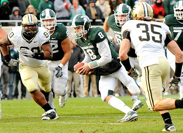 It looked like Michigan State's Rose Bowl quest was over. Then the Spartans scored 22 fourth-quarter points. Kirk Cousins threw two fourth-quarter touchdowns, ran for another and connected on a two-point conversion to fend off Purdue's upset bid and keep the Spartans alive in the Big Ten race.