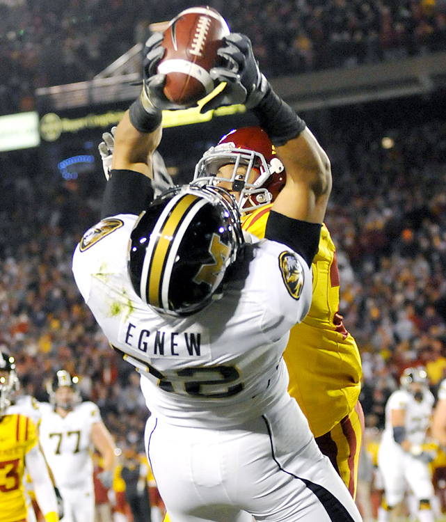 Blaine Gabbert threw this first-quarter touchdown pass to Michael Egnew and No. 15 Mizzou turned a fake punt into another score in its Big 12 North victory. On a chilly night in the heartland, Missouri (9-2 overall, 5-2 in the Big 12) sputtered offensively for most of the game. But the Tigers' defense remained stout and they made just enough plays with the ball to deny Iowa State (5-7, 3-5) the victory it needed for bowl eligibility.