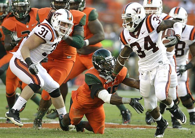 Virginia Tech's miraculous turnaround continues. Just over two months after opening the season with consecutive losses, the Hokies clinched the ACC Coastal Division with a win over fellow contender Miami. Tailback Ryan Williams rushed for 142 yards and two scores and the Hokies D picked off freshman quarterback Stephen Morris three times.