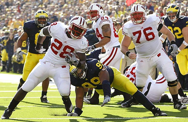 Nothing against John Clay, but Montee Ball and James White are flat-out tearing it up for Wisconsin in Clay's absence. The pair combined for 354 rush yards and six touchdowns against Michigan, leading the Badgers to their first win at the Big House since 1994. Wisconsin closes next week at home against Northwestern and is guaranteed at least a share of the Big Ten title with a win.