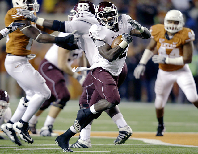 "Texas A&M heaped one final insult on Texas' miserable season. Cyrus Gray (center) rushed for 223 yards and had two long touchdowns as the Aggies sent the Longhorns to their first losing season since 1997. ""We set out at the beginning of the season to do this,"" Texas A&M senior center Matt Allen said. ""Beat Texas and win in November."" Gray had touchdown runs of 84 yards in the second quarter and 48 yards in the third."