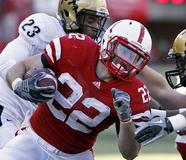 Rex Burkhead made sure Nebraska's final Big 12 regular-season game would be a laugher. Burkhead rushed 19 times for 101 yards and a touchdown and also completed both his passes for touchdowns as the Huskers won the Big 12 North and secured their spot in the Big 12 title game.