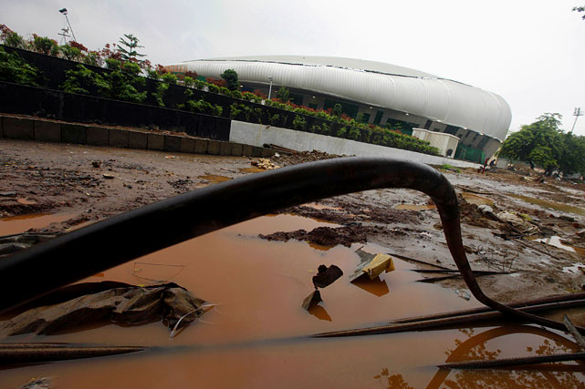 "After vowing to protect athletes from snakes and rhesus monkeys by employing snake charmers and tangur monkeys, the 11-day event in Delhi, India was threatened with cancelation mere days before it opened. Athletes expressed fears for their safety as many of the venues were still scenes of uncompleted construction chaos. A bridge collapsed near the main stadium and the athletes' village was pronounced ""unfit for human habitation"" by teams from Scotland, Canada, New Zealand and Ireland."