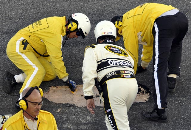 "With NASCAR in need of stronger TV ratings, The Great American Race turned out to be a circus of wrecks with a pothole seemingly imported from New York City's Cross Bronx Expressway causing two hours 24 minutes worth of stultifying delays that sent fans to the exits and prompted officials to issue an apology. By the end of the long day, Jamie McMurray was the surprise winner over Dale Earnhardt, Jr. who groused about ""21/2 miles of hole"" and complained about the track surface saying, ""It's so damn slick. It shouldn't be like this. It's 2010."""