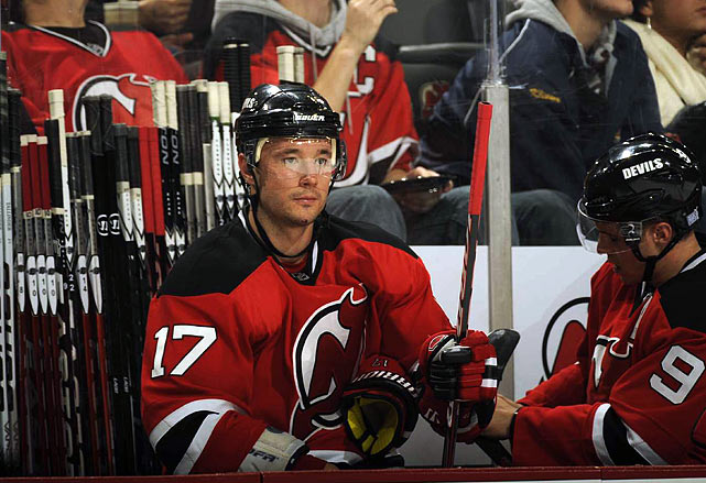 His initial 17-year, $102 million free agent contract brought down the wrath of NHL Commissioner Gary Bettman, whose charge of salary cap circumvention was upheld by an arbitrator, ultimately costing the Devils a $3 million fine and the loss of two draft picks. With a readjusted 15-year, $100 dollar deal in his pocket, the high priced sniper scored four goals, was a minus-10 in his first 19 games and got his butt benched for missing a team meeting as the Devils staggered to a 5-13-2 start.