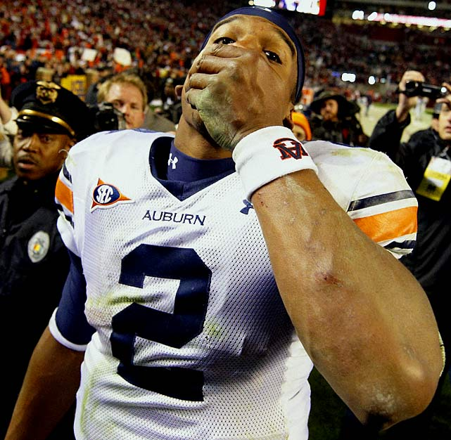 The University of Alabama fired an employee who played songs directed at Auburn quarterback Cam Newton -- whose father tried to arrange a pay-for-play plan for his son at Mississippi State -- during warmups at the Iron Bowl. What were the songs?  Take the Money and Run  and  Son of a Preacher Man . Alabama claimed the part-time staffer did not get those songs cleared.
