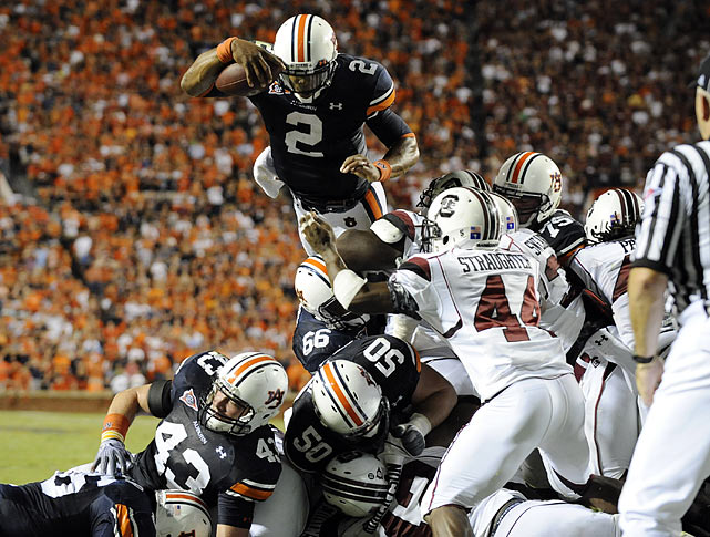 At Auburn, Newton had immediate success, gaining over 350 yards of total offense in his first game, against Arkansas State. Three weeks later, he helped the Tigers beat up on South Carolina, scoring five touchdowns in Auburn's 35-27 victory.