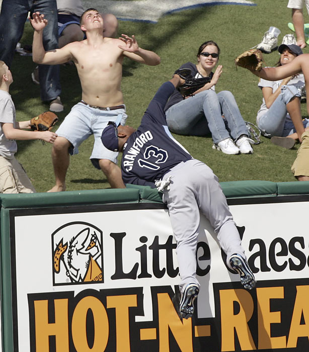Crawford takes a stab at a home run ball hit by Detroit's Marcus Thames  during a spring training game in Lakeland, Fla. The new Red Sox outfielder won one Gold Glove (2010) in his nine seasons with Tampa Bay.
