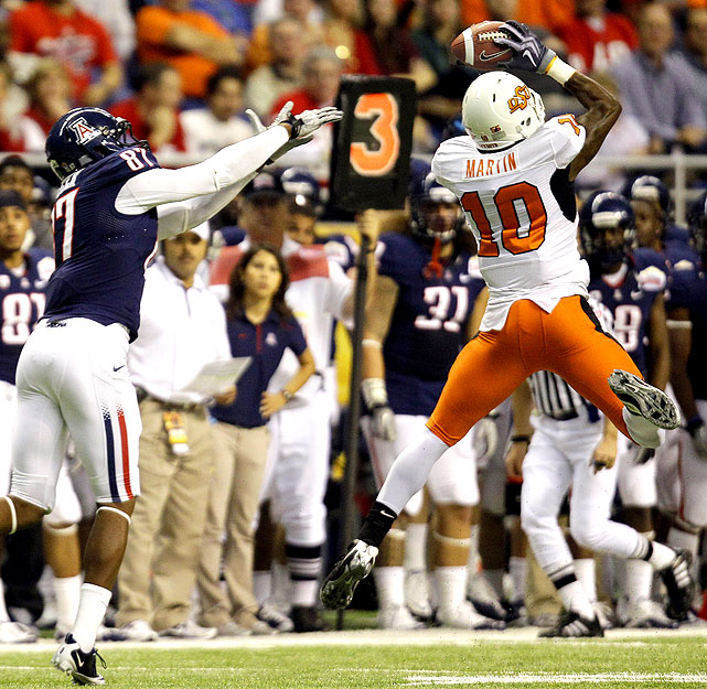 It was just too much Justin Blackmon and too many mistakes for Arizona. Blackmon caught two touchdown passes -- the 12th straight game in which he had at least one TD and 100 yards receiving -- and No. 16 Oklahoma State picked off three Arizona passes, including one that Markelle Martin returned 62 yards for a touchdown. The Cowboys never looked back after taking a 23-7 halftime lead.