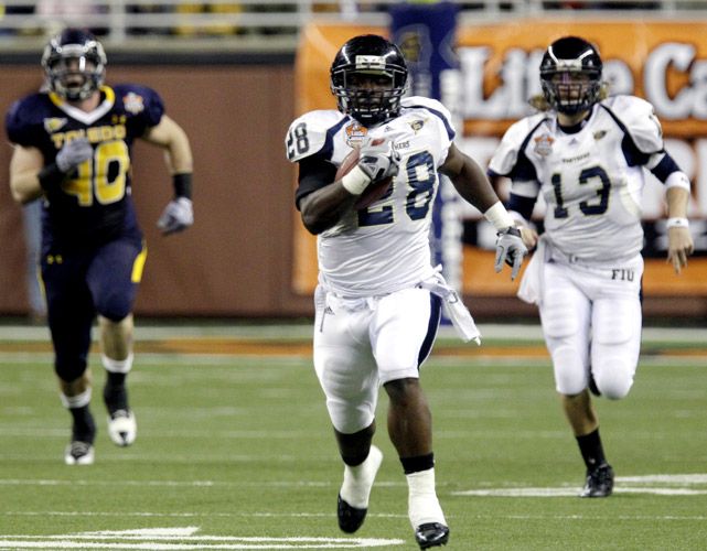 Florida International's first bowl appearance in history resulted in the school's first bowl victory in history. Thanks to a hook-and-ladder play on fourth-and-17 late in the game, FIU moved into field-goal range and set up Jack Griffin's 34-yard game-winning kick. Toledo went ahead late after converting a two-point conversion with less than two minutes remaining, but FIU's late drive turned the tide. Golden Panthers running back Darriet Perry (left) ran for 132 yards and two TDs in the victory.