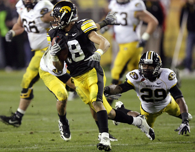 Micah Hyde returned an interception 72 yards for a touchdown as Iowa overcame the arrests of its top rusher and top receiver -- and 434 passing yards from Missouri's Blaine Gabbert. It was the Hawkeyes' school record third straight bowl victory.