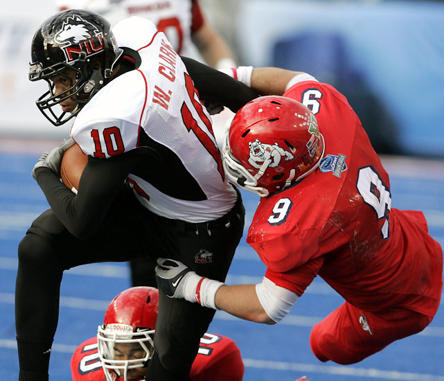 Northern Illinois closed out its best season in school history with a 23-point rout over Fresno State. The Huskies won 11 games for the first time in team history were boosted in the Humanitarian Bowl by quarterback Chandler Harnish, who threw for two touchdowns and scored another on the ground.
