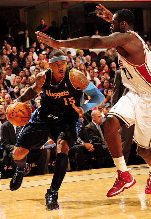 In a classic duel between superstars, Carmelo Anthony nailed the game-winning jumper over LeBron James with 1.9 seconds left as Denver snapped host Cleveland's 13-game winning streak. Anthony finished with 40 points while James countered with 43 points, 13 rebounds and 15 assists.
