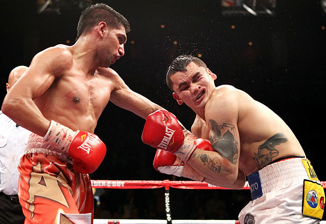 Khan was the skilled technician with the dodgy chin. Maidana was the crude slugger with the slightly less dodgy chin. Khan sprinted out to an early lead on the scorecards when they met for his WBA junior welterweight title in Las Vegas, but Maidana roared back down the stretch -- nearly knocking out Khan in the 10th round. In the end, Khan survived and won a slim unanimous decision.