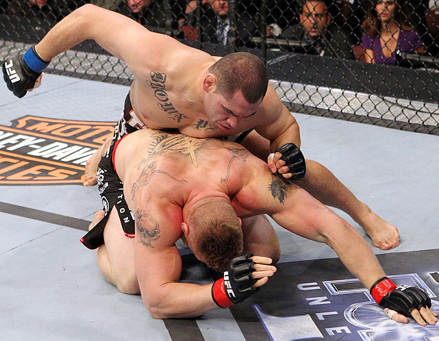 """Velasquez, 28, needed just nine pro bouts to prove his worth against Lesnar -- the most marketable heavyweight in the sport who, in just seven fights, took the belt and captivated audiences with his power and persona. Velasquez's rousing first-round stoppage of Lesnar was a superlative performance, one the new champion called """"almost perfect"""" as Velasquez became the first fighter of Mexican descent to hold a major combat sports heavyweight title."""