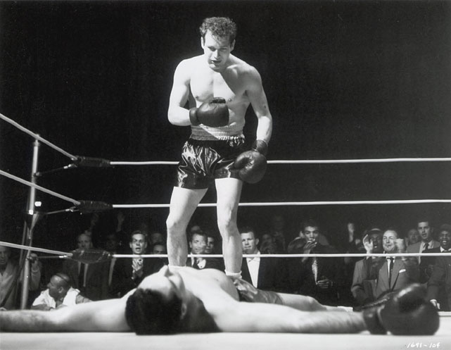 "Directed by Robert Wise. Starring Paul Newman, Eileen Heckart, Sal Mineo.   THE STORY  The long and unlikely journey of New York's Rocky Graziano (Newman) from Lower East Side juvenile delinquent to hoodlum to U.S. Army deserter to world middleweight champion gets the Hollywood treatment.  THE LEGACY  James Dean was slated to play the role of Graziano, with Newman only stepping in after the icon's untimely death.  THE QUOTE  ""Everybody who is young is promising. The world should sue the young for breach of promise.""  --Rocky Graziano (Newman)"