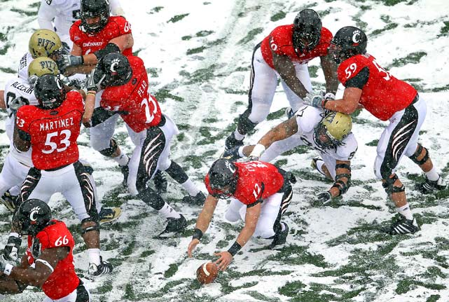 Zach Collaros of the Cincinnati Bearcats reaches for a fumble during the Big East Conference game against the Pittsburgh Panthers at Nippert Stadium on December 4 in Cincinnati, Ohio. Pittsburgh won 28-10.