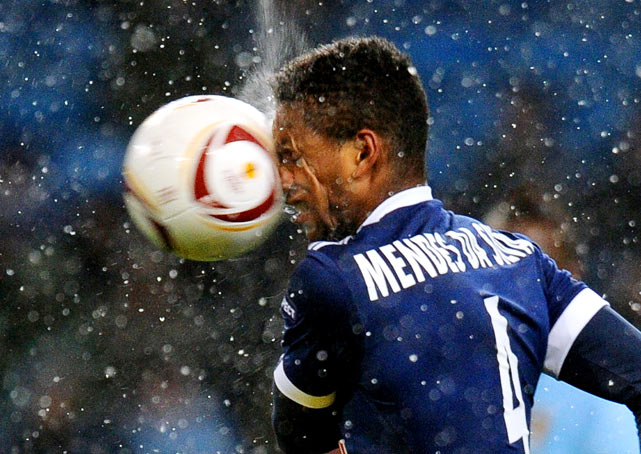 FC Red Bull Salzburg's Dutch midfielder David Mendes da Silva is hit in the face with the ball during the UEFA Europa League group A football match against Manchester City December 1 at The City of Manchester stadium, Manchester, England.