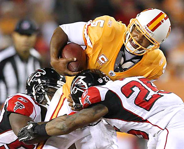 Tampa Bay Buccaneers quarterback Josh Freeman is tackled by Atlanta Falcons linebacker Curtis Lofton and safety William Moore during their gameat Raymond James Stadium on December 5 in Tampa. Atlanta defeated Tampa Bay 28-24.