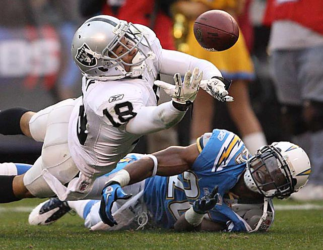 Oakland Raiders wide receiver Louis Murphy can't hold on to a catch as San Diego Chargers cornerback Antoine Cason falls during their December 5 game in San Diego. The Raiders defeated the Chargers 28-13.