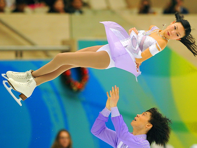 Pang Qing (top) and Tong Jian of China perform in the pairs final during the Grand Prix final in Beijing on Dec. 10. The Chinese favorites finished behind Aliona Savchenko and Robin Szolkowy of Germany.