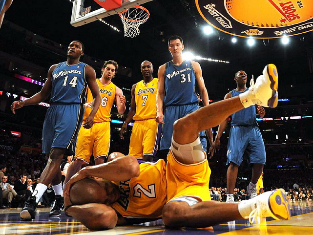 The Lakers' Derek Fisher grabs his head after a hard fall during a game against the Wizards at the Staples Center in Los Angeles on Dec. 7. The Lakers defeated the Wizards 115-108.