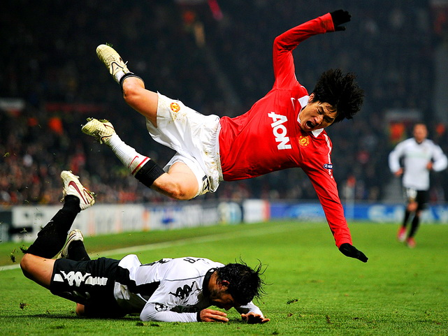 Ever Banega of Valencia brings down Park Ji-sung of Manchester United during a 1-1 tie in the UEFA Champions League Group C match in Manchester, England, on Dec. 7.