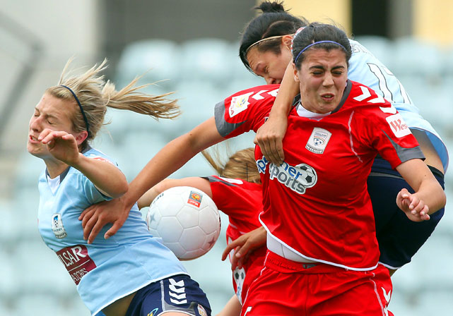 Stacey Day of Adelaide (right) and Danielle Brogan of Sydney (left) compete for the ball from an incoming corner kick during their round six W-League match between Adelaide United and Sydney FC at Hindmarsh Stadium in Adelaide, Australia on Dec. 18. Sydney defeated Adelaide 4-0.