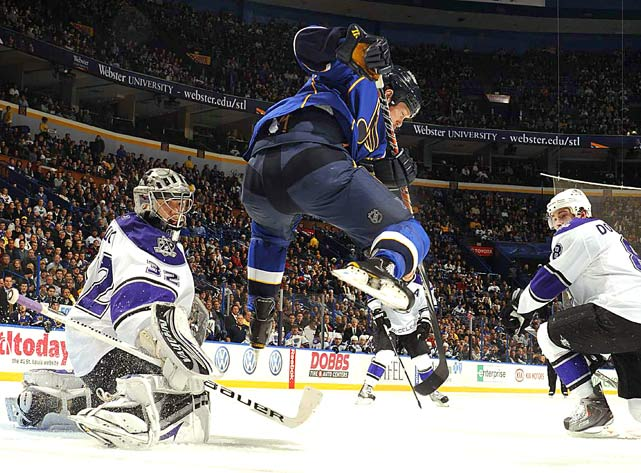St. Louis Blues' leftwinger Brad Winchester leaps into the air as he deflects the puck into the net to score on Los Angeles Kings goalie Jonathan Quick (left) during the second period of their game on Dec. 16 in St. Louis. The Blues defeated the Kings 6-4.