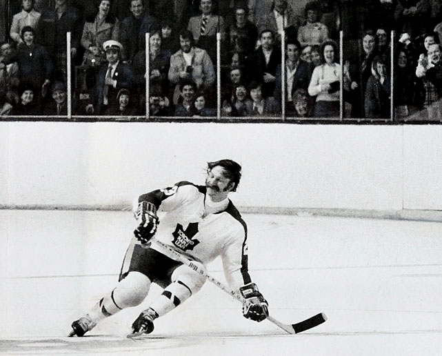 "His nicknames – ""The Entertainer"" and ""The Nose"" – said  it all. The feisty, exuberant forward often led Maple Leafs fans in chants of  ""We want Shack!"" and even inspired a song called, ""Clear the Track, Here Comes  Eddie Shack."" And you had to admire his honesty. After scoring a Stanley  Cup-winning goal for the Leafs, he told reporters the puck had actually hit him  in the caboose and gone in the net while he was trying to get out of the way.  Shack also had an appetite for pugilism and famously resumed a brawl with Larry  Zeidel…in the stands where they'd gone after being tossed for having a nasty  stickfight."