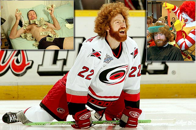 The carrot-topped blueliner became something of an icon  during the Carolina Hurricanes' run to the Stanley Cup in 2006, thanks to his  fright wig hair and bathrobes. A rather arresting self-taken photo of him  wearing nothing but skivvies and his Super Bowl winnings has circulated on the  internet.