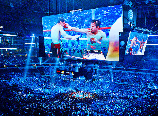 As seen on Cowboys Stadium's video screen, Manny Pacquiao (right) lands a right hook on Antonio Margarito during their WBC super welterweight title fight in Arlington, Texas. Pacquiao would defeat Margarito in 12 rounds.