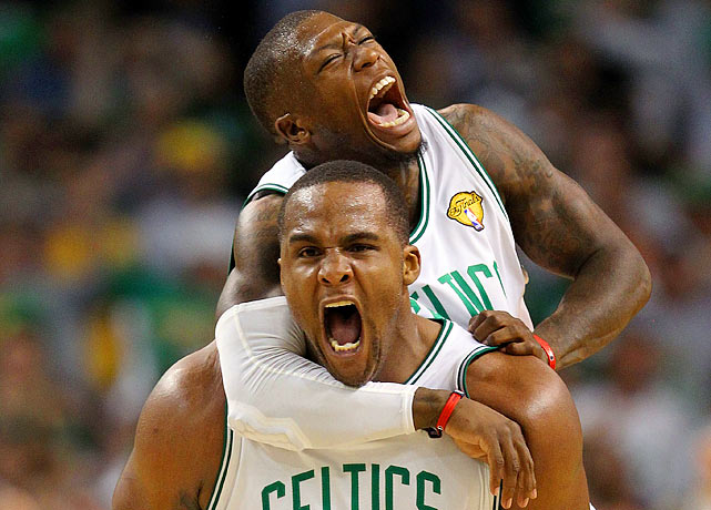Glen Davis (below) and Nate Robinson exult during the fourth quarter of Game 4 of the NBA finals.  The Celtics' reserves were instrumental in Boston's late-game surge against the Lakers in a 96-89 Celtics victory.