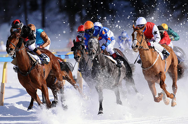 Horses gallop through the snow during the Gübelin Grand Prix in St. Moritz, Switzerland.