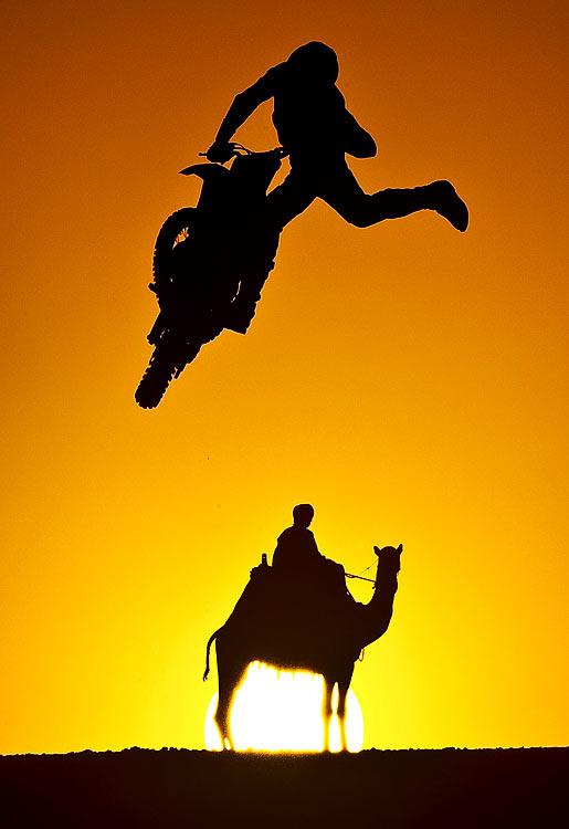Australian freestyle motocross rider Robbie Maddison jumps into the sunset during a training session in the Sahara desert in preparation for the second stage of the Red Bull X-Fighters World Tour.