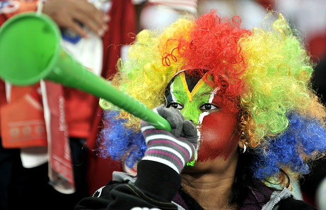 A World Cup fan blows a vuvuzela before Nigeria played South Korea in the World Cup at Moses Mabhida Stadium in Durban, South Africa. The presence of vuvuzelas at the Cup prompted other organizations, including the NFL, UEFA and FIBA, to ban the horns from future events.