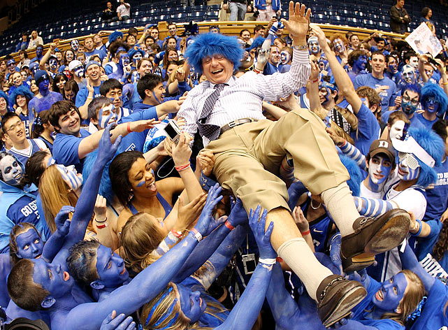 College basketball analyst Dick Vitale crowd surfs among the Cameron Crazies before the start of the North Carolina Tar Heels-Duke Blue Devils game at Cameron Indoor Stadium in Durham, N.C.  Duke would defeat the Tar Heels 82-50.
